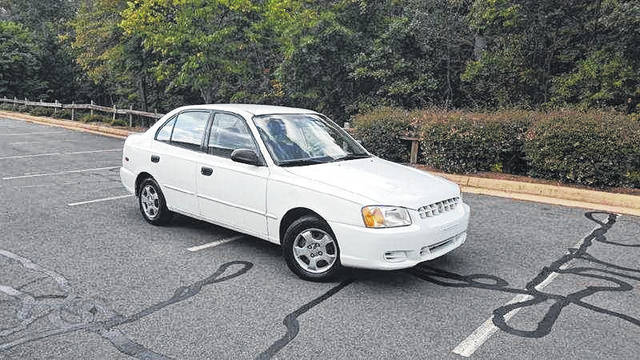 Tammy Neace, 45, allegedly involved in the shooting death of another woman in the Village of Pomeroy on Wednesday, is reportedly driving a white 2001 Hyundai Accent four door, pictured, with Ohio license plate number FIX8138.