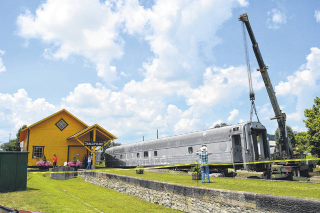 The Gallipolis Railroad Freight Station Museum placed its passenger car on rails Wednesday. A former Ringling Brothers and Barnum and Bailey's circus car, museum board members commented that if train cars could talk, the passenger car could write books.