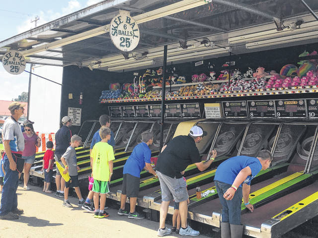 Fair goers enjoying some skee-ball at last year's Mason County Fair.