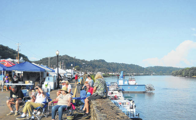 Boats lined the dock at Pomeroy, so passengers could enjoy the music from the Blues Bash. Bash goers enjoyed the scenery of the Ohio River.