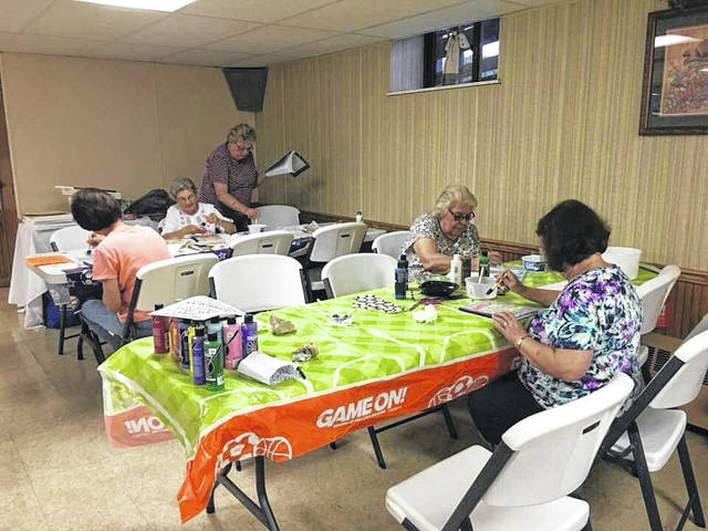 Adults enjoying their crafting activities during last years Community VBS.