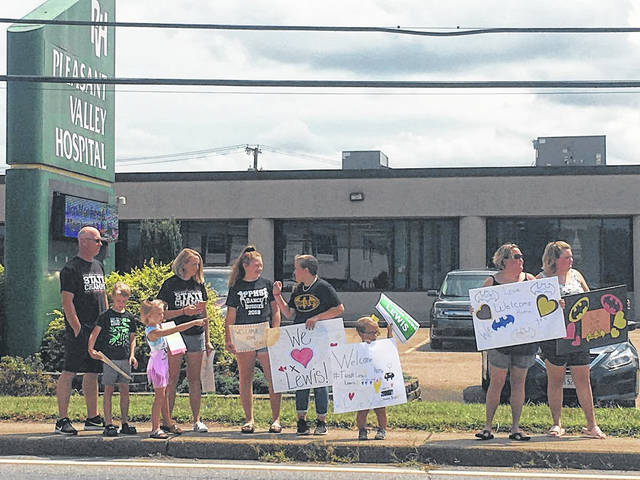 Several people had special welcome home signs made up for Lewis Bryant Jr.