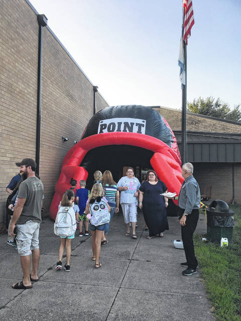 For their first day back at Beale Elementary students were greeted by their Principal Adam Watson. The students and teachers were able to walk through the Point Pleasant High School Football Helmet surrounded by smoke from a smoke machine and music.