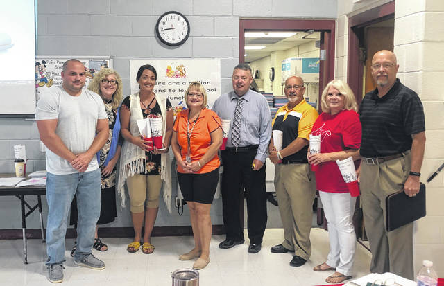 Judy Browning, PPPS Teacher of the Year and PPPS Title I reading specialist, was recognized on the opening day for staff at PPPS. Those pictured with Mrs. Browning are Dr. Kenny Bond, director of curriculum and instruction; John Lehew, director of special education; Mason County Board of Education Members, Jared Billings, Rhonda Tennant, Ashley Cossin, and Dale Shobe; and Principal Vickie Workman.