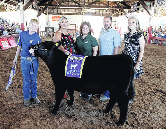 Kade McCutcheon's reserve champion feeder calf sold for $6 per pound to Pleasant Valley Hospital, Cabell Huntington Hospital, Marshall University Joan C. Edwards School of Medicine, Peoples Bank, Wilcoxen Funeral Home, representatives pictured as well as Fair Queen Marlee Bruner.