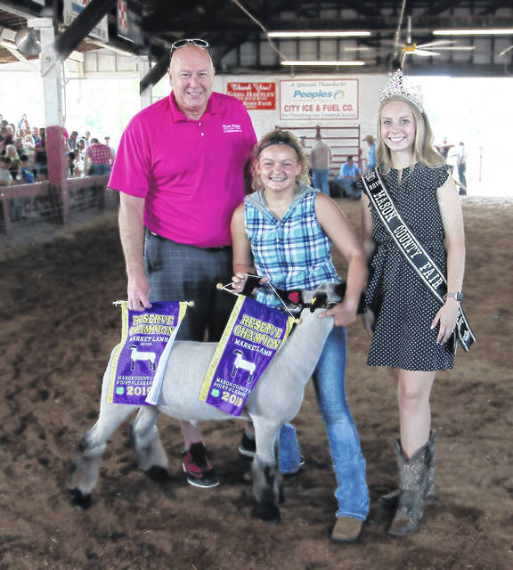 The annual livestock sale took place at the Mason County Fair on Friday. Pictured is Zoie Mayes who showed the reserve champion lamb that sold for $24 per pound to Mark Porter GM Supercenter. Also pictured, Mark Porter as well as Fair Queen Marlee Bruner. Nathan Wood's grand champion goat sold for $45 per pound to APG and People's Bank, representatives pictured as well as Fair Queen Marlee Bruner. More from the livestock sale inside this edition and online at www.dailyregister.com.