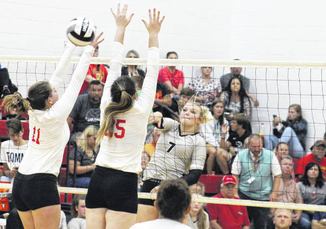 River Valley junior Taylor Huck (7) spikes the ball between South Gallia's Olivia Johnson (11) and Christine Griffith (25), during the Lady Raiders' straight games win on Monday in Mercerville, Ohio.