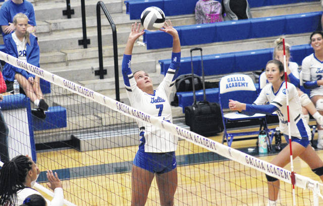 Gallia Academy senior Peri Martin (7) sets the ball in front of teammate Abby Hammons (11), during the Blue Angels' straight games win on Tuesday in Centenary, Ohio.