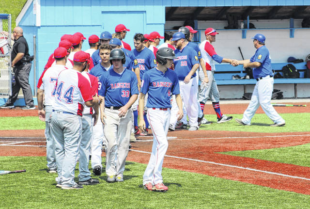 Members of Meigs Post 39 shake hands with members of the Sidney Post 217 squad following Friday afternoon's 2019 Ohio American Legion state baseball tournament game at Beavers Field in Lancaster, Ohio.