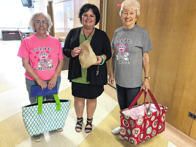 This week, CEOS club members set out to raise money, and awareness, to fight breast cancer with monthly food sales and deliveries. This week, customers were treated to hotdogs with sauce for lunch. CEOS clubs across the county host several events in October for Breast Cancer Awareness Month, including its annual Walk for Women. Pictured at center, Mason County Circuit Court Clerk Elizabeth Jones purchases lunch from CEOS members Mary Sue Kincaid (far left) and Phyllis Hesson. For delivery requests, contact the Mason County Extension Office at 304-675-0888.