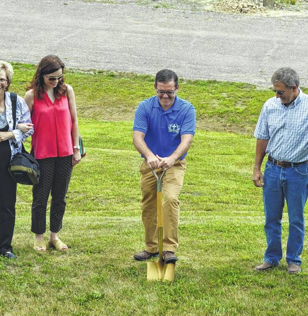 Pastor Heath Jenkins of Vinton Baptist Church breaks ground for the Hope House in 2016.