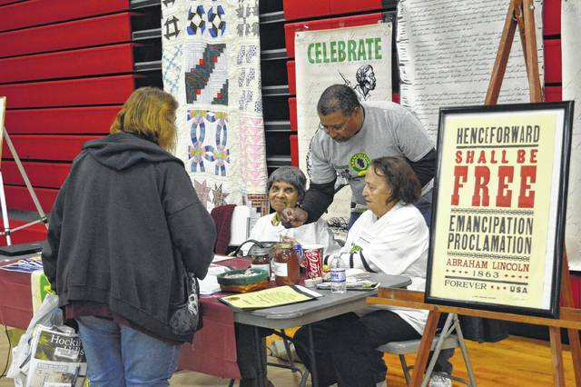 Here the Emancipation Celebration Day Committee speaks with a visitor during a past Southeast Ohio Tourism and Business Expo. The Emancipation Proclamation Celebration is the longest running of its kind and is held every fall.