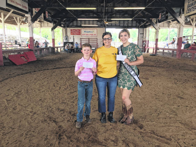 Awards were presented to youth at the Mason County Fair on Friday, prior to the livestock sale. Ben Supple, on left, and Kadann Bonecutter, on right, were the recipients of the Donnie Hill Award which was presented to them by WVU Extension Agent Lorrie Wright. Also pictured, People's Bank Branch Manager Valerie Johnson, on left, and Personal Banker Katelyn Hendrix announced the winners for the 2019 People's Bank Fair Scholarship Awards, Hayley Russell, alternate place; Kauri Porter, third place (not pictured); Jacob Shull, second place; and Sarah Deem, first place. More awards appear inside and online at www.mydailyregister.com.