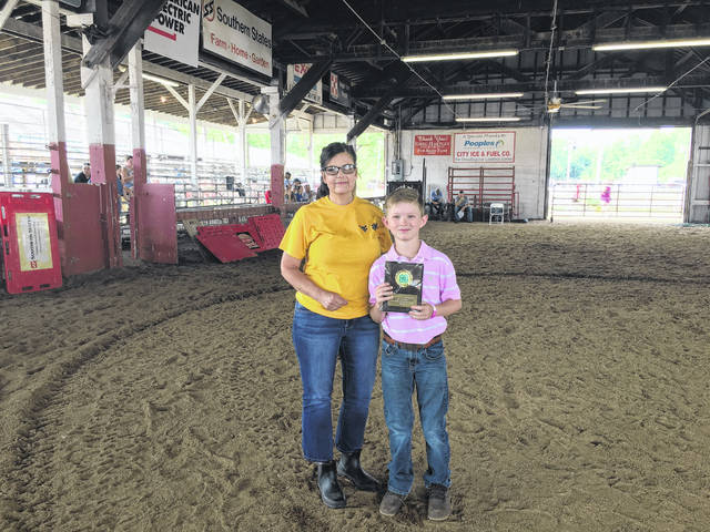 Ben Supple was chosen as the outstanding 4-H exhibitor, he is pictured with WVU Extension Agent Lorrie Wright.