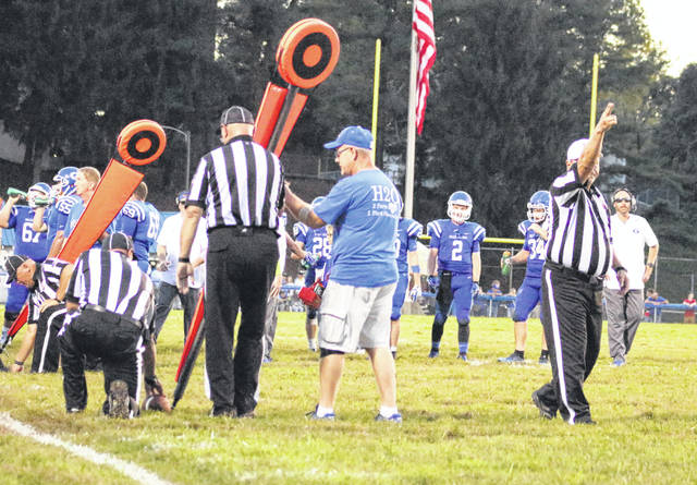 Gallia Academy football coach Alex Penrod, far right, looks on during a measurement that determines a first down during the first half of a Sept. 1, 2018, contest against River Valley at Memorial Field in Gallipolis, Ohio.