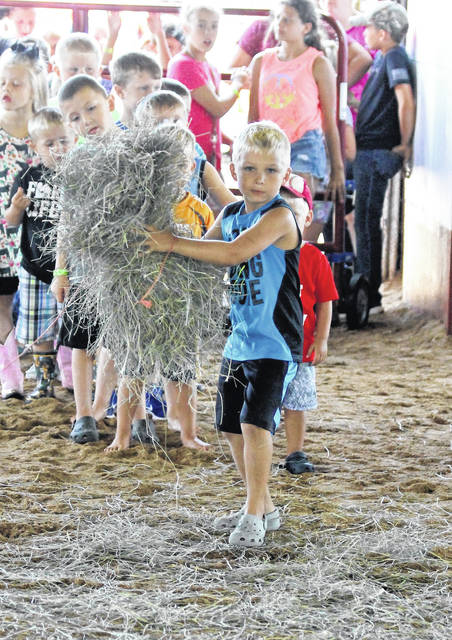 Fun at the hay bale toss.