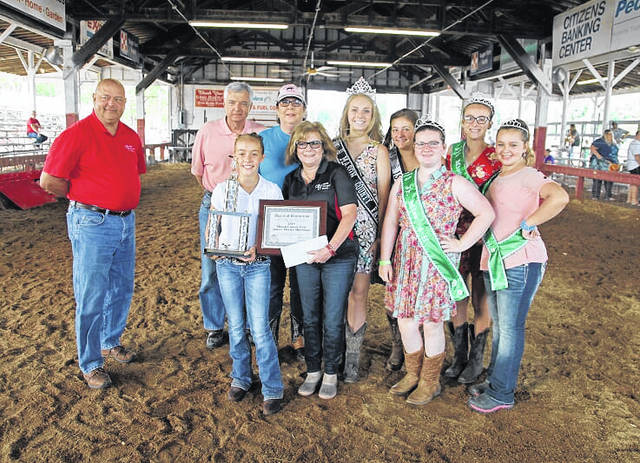 Winning Senior Master Showmanship, an award sponsored by Ohio Valley Bank, is Maddison Keefer, pictured on right. Winning Junior Master Showmanship, an award sponsored by Ohio Valley Bank, is Chloe Patrick, pictured on left, Also pictured are representatives from OVB, along with fair and 4-H royalty.
