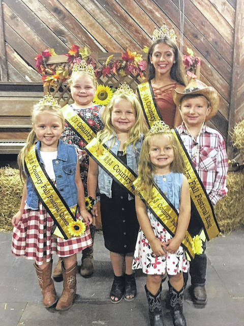 The newly crowned Country Fall Festival Royalty includes: front row, Peyton Crouch, Wee Miss Queen; second row, Lillie McCoy, Tiny Miss Queen; Henley Taylor, Little Miss Queen; and Cole Washington, Little Mister King. Third row, Makayla Billings, Young Miss Queen; and Katie Cullen, Junior Miss Queen.