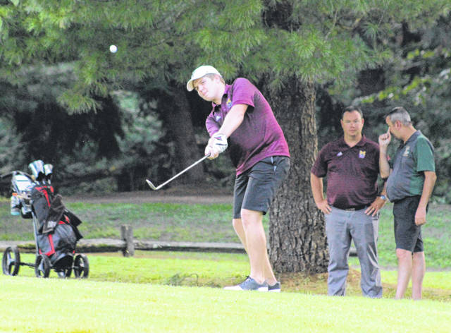 Meigs senior Austin Mahr hits a chip shot onto the green at the sixth hole of Tuesday night's TVC Ohio golf match at Meigs Golf Course in Pomeroy, Ohio.