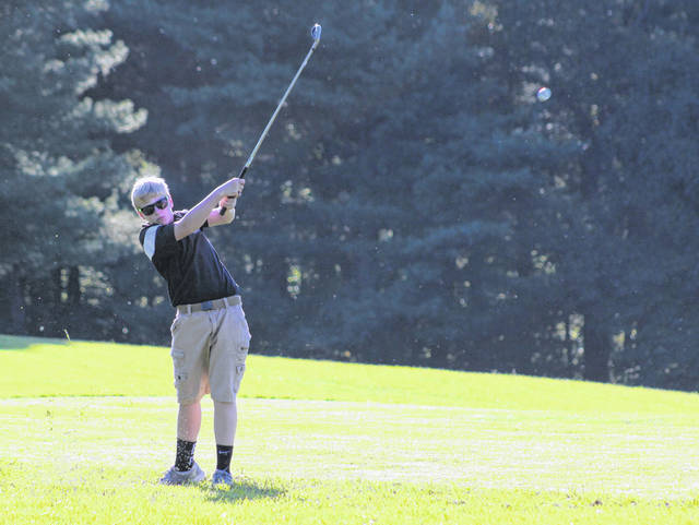 Point Pleasant freshman Kaden McCutcheon hits a fairway shot on the eighth hole during Thursday night's quad golf match at Meigs Golf Course in Pomeroy, Ohio.