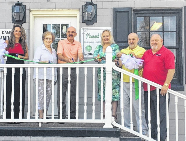 A ribbon cutting was recently held for Pleasant View Professional Counseling, LLC., located at 610 ½ Main Street, Suite B, upstairs right in the Shaw & Shaw office in downtown Point Pleasant, W.Va. Pleasant View provides mental health counseling for West Virginia and Ohio residents, adults and children ages 10 and up. Counselor Samantha Fooce offers assessment and counseling services on Mondays, Wednesdays and Thursdays by appointment from 11 a.m. - 7 p.m., with evening hours and telehealth available to meet the needs of students and those employed. Please call 304-675-5775 to schedule an appointment and check Facebook or pleasantviewcounseling.com for information and updates. Pictured at the ribbon cutting, from left, City Clerk Amber Tatterson, Mason County Chamber Director Hilda Austin, Mayor Brian Billings, Fooce and husband Kevin Fooce, Larry Jones, chamber vice president.