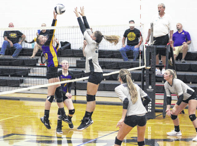 Southern junior Jordan Hardwick, left, hits a spike attempt in front of River Valley junior Hannah Jacks during Game 2 of Thursday night's non-conference volleyball match in Bidwell, Ohio.