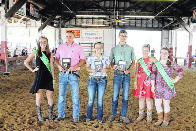 This week the fair recognized the top showmen (and women) for their skills exhibiting and handling their livestock projects. Pictured are winners of the Senior Showmanship for Market Hog, Dalton Dangerfield, first place; Emily Bale, second place; Levi Wright, third place. Also pictured are winners of the Junior Feeder Calf Showmanship, Eden Johnson, first place; Marlee Carr, second place; Liam Durst, third place. In addition, presenting the winners with awards are Junior Miss 4-H Alasaundra Reed, Miss 4-H Karli Stewart, Young Miss 4-H Riley Springston.