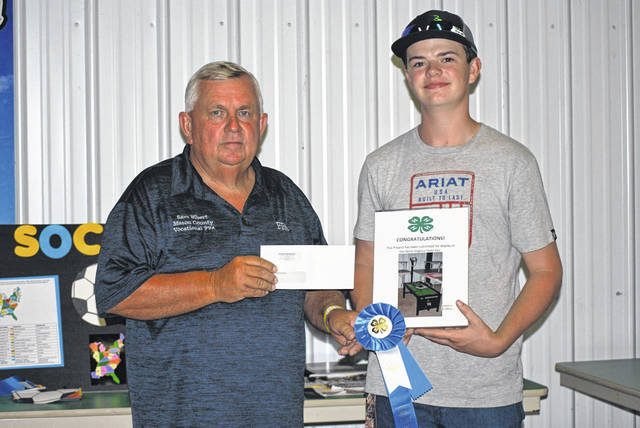 Kailynn Weaver, FFA member from Wahama, won one of two top welding awards and was presented with a cash award sponsored by Letart Corporation. Weaver is pictured with Commissioner Sam Nibert who also teaches at the Mason County Career Center.