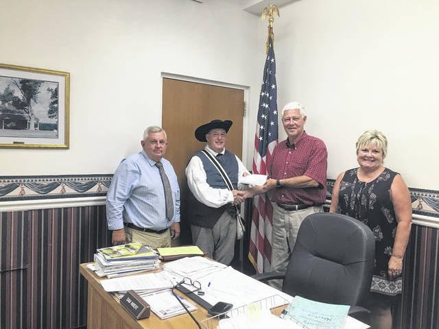 The Mason County Commissioners present Ed Cromley, second from left, a check donation for the upcoming Battle Days festival. Also pictured Commissioners Sam Nibert, Rick Handley and Tracy Doolittle.