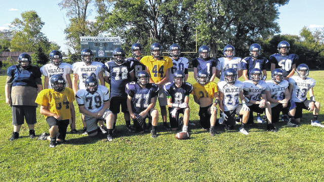 Members of the Hannan football team pose for a picture at the Craigo Athletic Complex after the program received its new helmets on Aug. 15 in Ashton, W.Va.