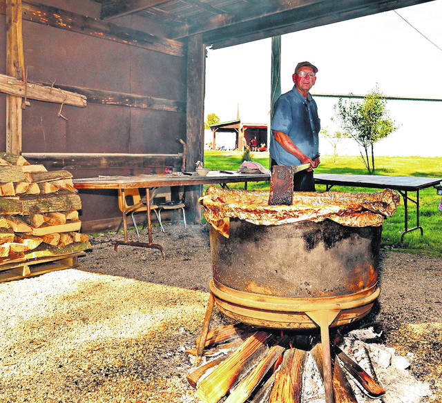 Festival goers enjoy making apple butter at the Country Fell Festival.