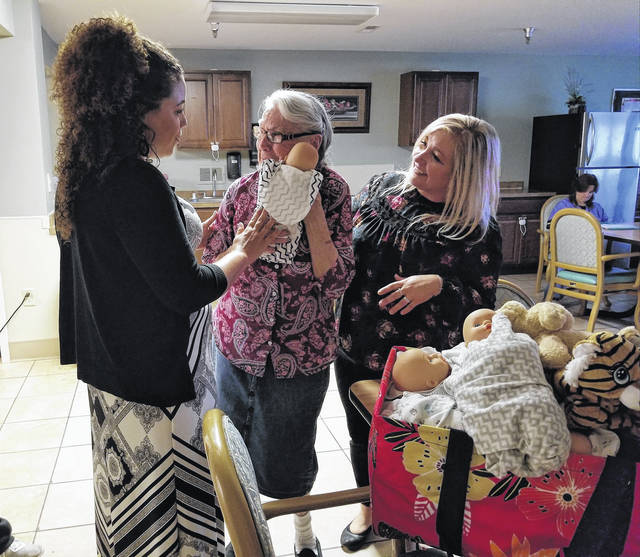 The Stork Project shares gifts with Abbyshire Place residents.