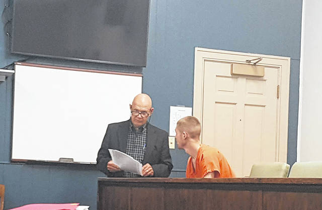 Austin Halfhill, right, talks with Attorney Michael Huff before Halfhill's arraignment on Wednesday morning.