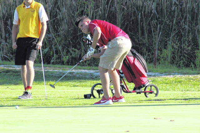 Wahama's Conner Ingles putts on the fifth green at Riverside Golf Club on Sept. 4 in Mason, W.Va.