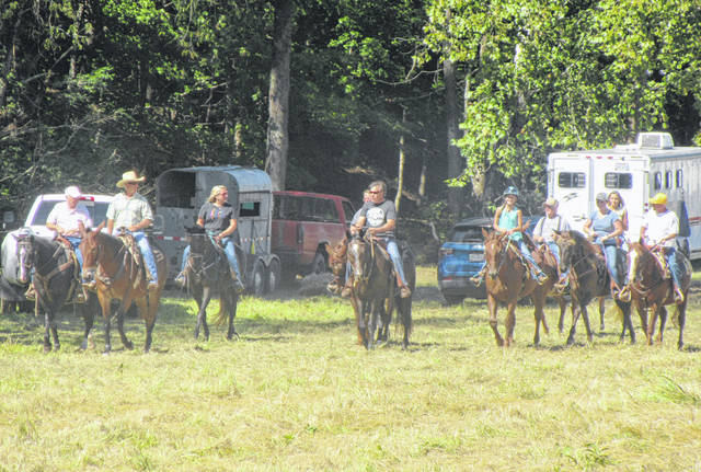 Horses and riders headed out on the trail during the 23rd annual St. Jude Trail Ride at the Dill Farm in 2018.