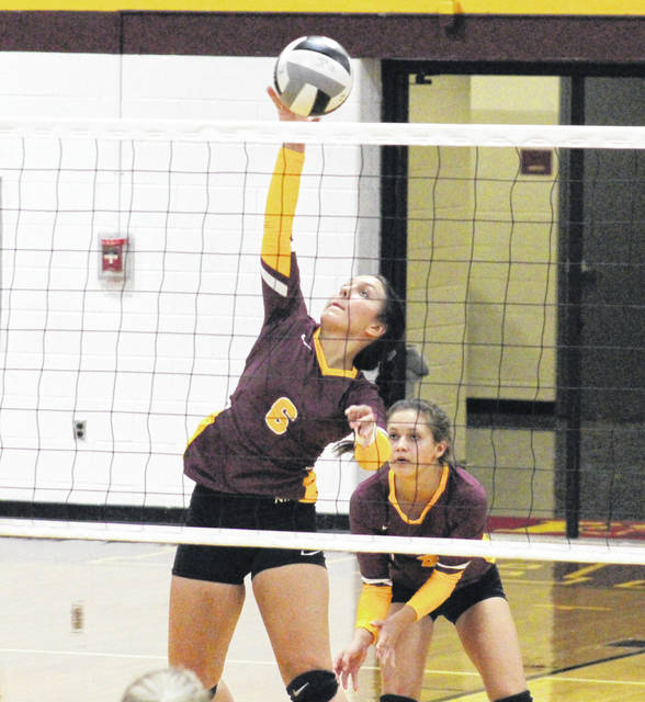 Meigs senior Maci Hood (6) attempts a spike in front of teammate Kylee Mitch, during the Lady Marauders' Aug. 22 loss to Eastern in Rocksprings, Ohio.