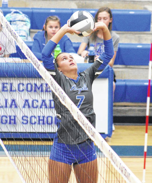 GAHS senior Peri Martin (7), the school's all-time leader in assists, sets the ball, during the Blue Angels' sweep of Coal Grove on Thursday in Centenary, Ohio.