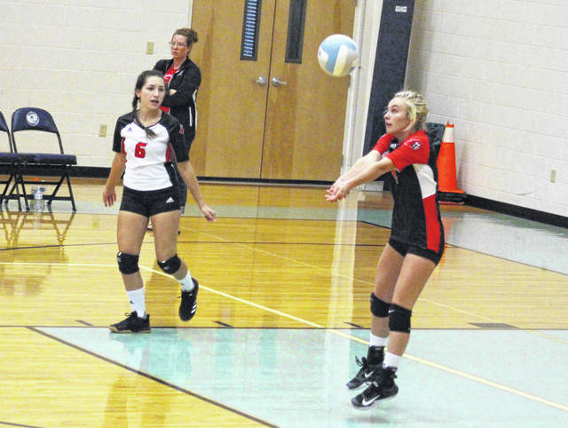 Point Pleasant senior Peyton Jordan, right, bumps a ball in the air during Game 3 of Tuesday night's volleyball match against Ohio Valley Christian in Gallipolis, Ohio.
