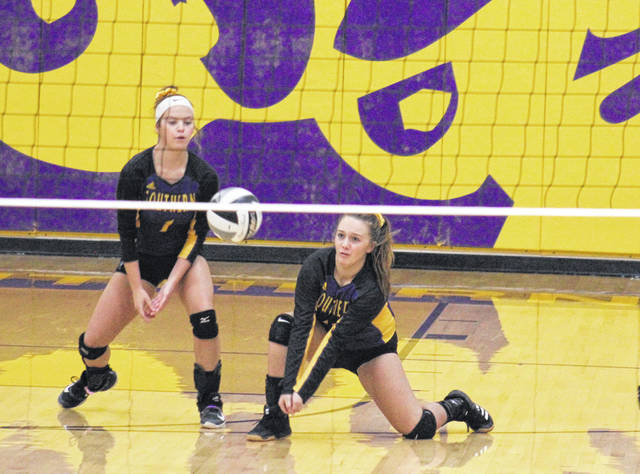 Southern junior Abby Rizer (right) receives a serve in front of teammate Kassie Barton (1), during the third game of the Lady Tornadoes sweep of South Gallia on Monday in Racine, Ohio.