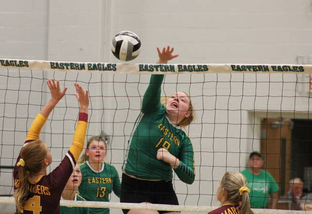 Eastern junior Layna Catlett (19) attempts a spike, during the Lady Eagles' 3-1 victory over Meigs on Tuesday in Tuppers Plains, Ohio.