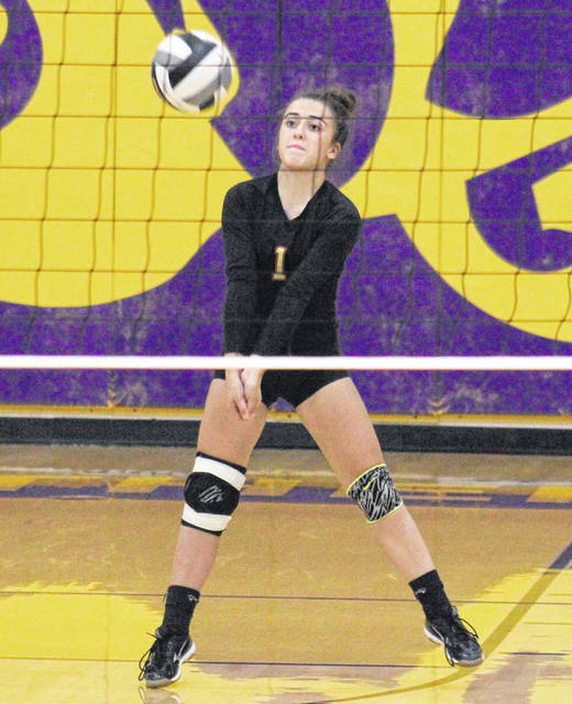 South Gallia senior Alyssa Cremeens (1) receives a serve, during the Lady Rebels' match Sept. 23 match against Southern in Racine, Ohio.