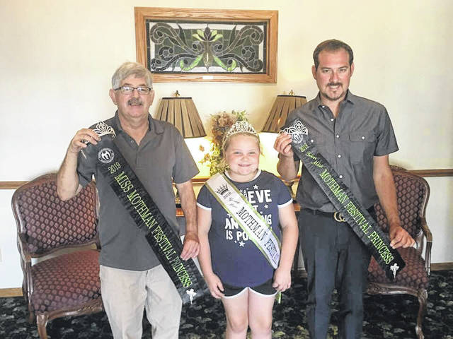 David and Brad Deal of Deal Funeral Home are this years sponsors of the Teen Miss and Miss Mothman Festival Princess crowns and sashes. They are pictured with Makayla Billings, 2018 Young Miss Mothman Festival Queen. Deal Funeral Home also offered to buy additional awards for this year's pageant.