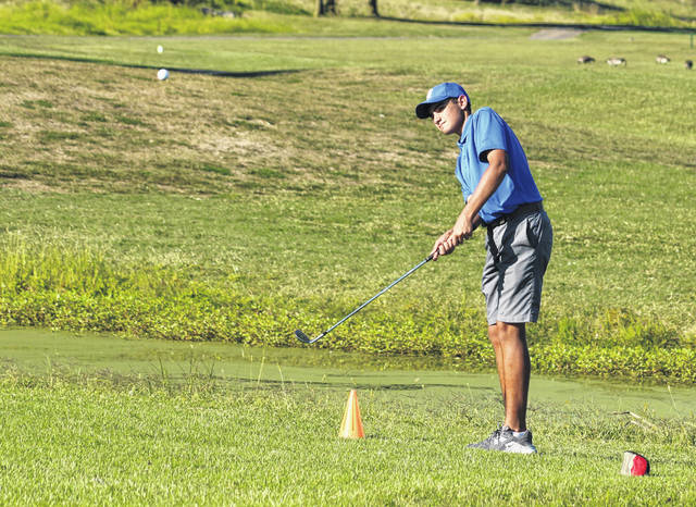 Gallia Academy freshman Laith Hamid hits a chip shot during Thursday night's tri-match at Cliffside Golf Course in Gallipolis, Ohio.