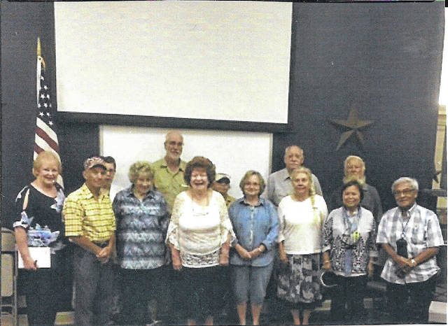 Members and guests of the Point Pleasant Writers Guild pose for a picture with author, Michael Connick, pictured back row, second from left.