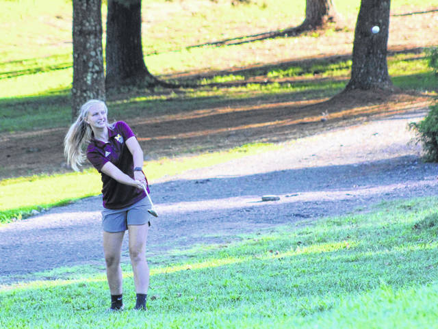 Meigs junior Olivia Haggy hits a chip shot during an August 29 golf match at Meigs Golf Course in Pomeroy, Ohio.