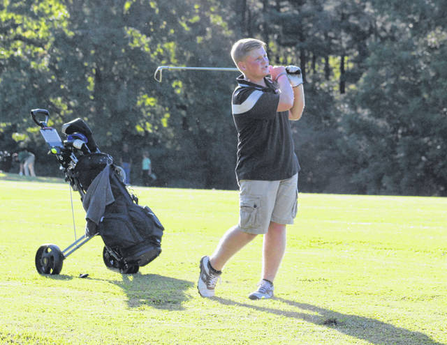 Point Pleasant sophomore Alex Hill watches a shot from the fairway during an Aug. 29 match at Meigs Golf Course in Pomeroy, Ohio.