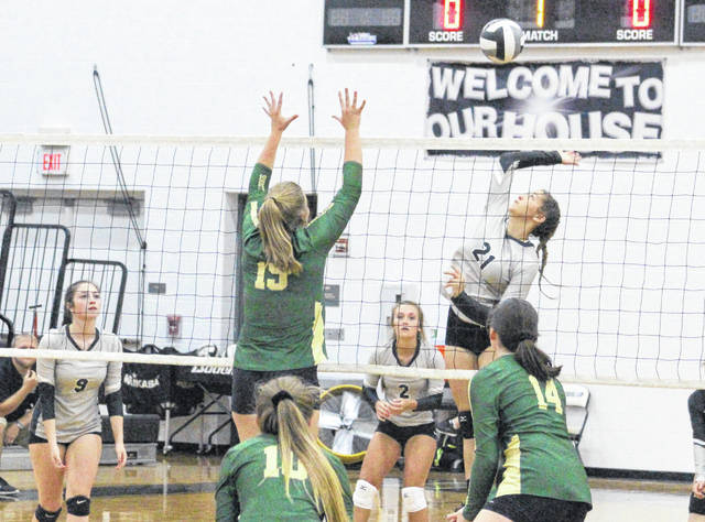 River Valley senior Kasey Birchfield (21) goes up for a spike attempt during a Sept. 10 match against Athens in Bidwell, Ohio.