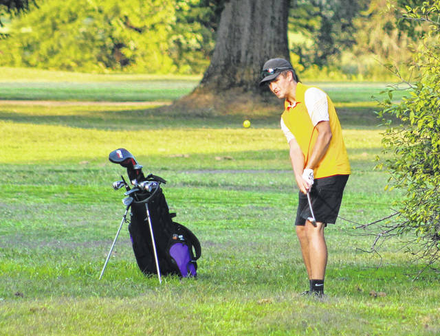 Southern senior Landen Hill hits a chip shot on the seventh hole during Wednesday's TVC Hocking golf match at Riverside Golf Course in Mason, W.Va.