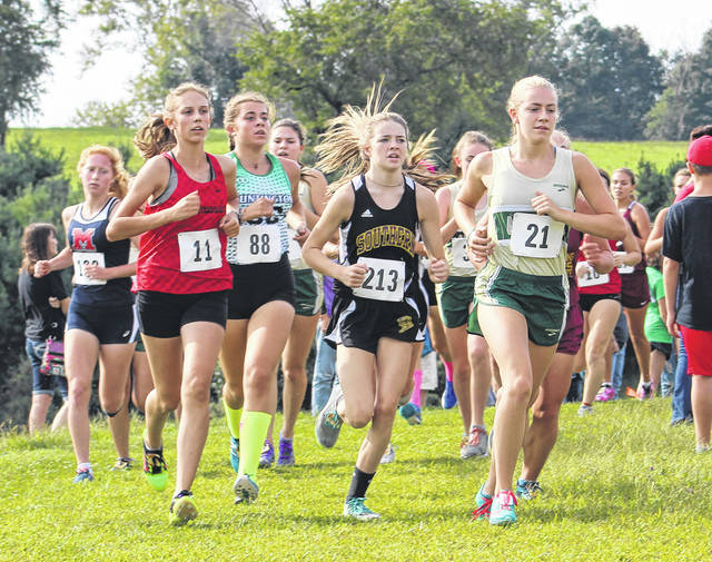 Southern senior Sydney Roush (213) keeps pace with the pack during Saturday's varsity girls race at the 2019 Vinton County Invitational held in McArthur, Ohio.