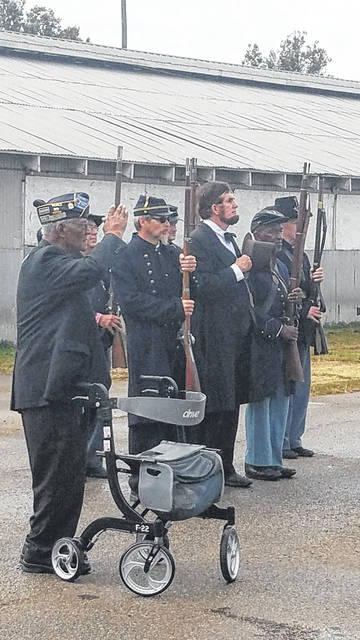 Veterans and reenactors salute in memory of the struggles of the US.